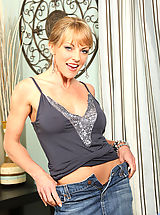 Jeans Pics: Adorable milf Shayla Laveaux spreads her legs exposing her pussy and her pink clitoris on the sofa