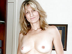 Celebrity Vids: Brown eyed cougar shows off her perky tits