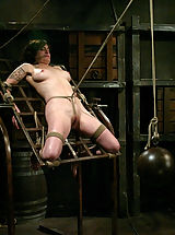 Naked Fetish, Stacey discovers a harsh crotch rope for the first time.