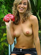 Outdoors Nippels, Melanie in the garden wearing a red tie-die top with a pinstripe skirt with white cotton panties.