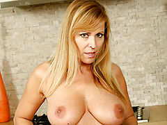 Milf Vids: Nicole Moore eagerly shows off her superb oral talents on an innocent dildo