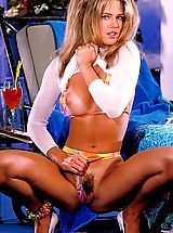 Stiff Nipples, Racquel Darrian covers her magnificent body glistening with oil while sunbathing