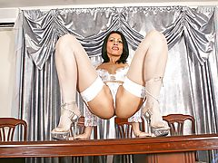 Milf Vids: Exotic and seductive, nelli, slowly removes her black corset