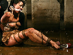 Breastfeeding Nipple, Petite brunette is bound and abused in an underground dungeon