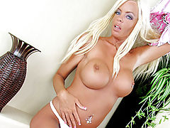 Erect Nipples, Tanned blonde removes her dress exposing her huge tits