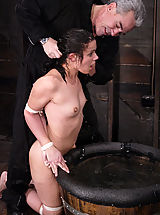 Fetish Pics: Penny gets tiled up, blindfolded, and sprayed down with water