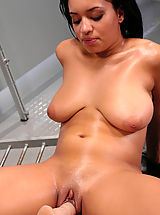 Black Pics: Hot black babe with huge natural tits gets machine fucked.