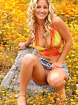Outdoors Nippels, Lia 19 plays in a bed of flowers