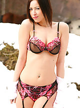 Outdoors Pics: Beautiful brunette does a sexy strip from her office outfit in the Bulgarian snow.