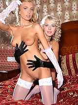 Big Nipple Pictures, Gorgeous girls Malgina and Kira strip each other down to their stockings on the bed.