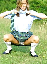 Upskirt Pics: Melanie takes a wander in the park wearing a college uniform consisting of tartan skirt