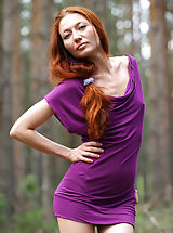 Skinny redhead Kesy shows off her naked beauty in the forest