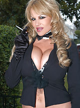 Kelly rubs on her pussy in torn fishnets, bow tie and a top hat.