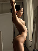 Women with big Areola, A perfect little ballerina admires herself in the mirror as she stretches her slender body.