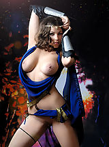 Busty brunette warrior babe taking off her blue dress