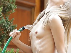 Vintage Vids: Petite blonde Chastity Lynn brings ultimate pleasure to her hot pussy with a cool stream of water from the garden hose
