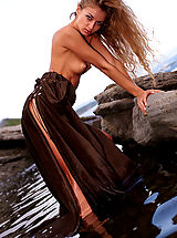 True Beauty Nippels, Gorgeous redhead shows her pussy posing on the rocks