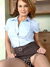 Upskirt Pics: Busty cougar Rebecca Bardoux makes her finger moist and slides it in her hot pussy