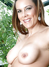 Aerolos, Brunette Anilos Victoria loves to expose her experienced shaved pussy while she hangs out in her garden