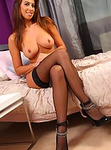 Naked Big.Tits, Sexy brunette shuts herself in her bedroom and gives a sexy striptease out of her tight black corset and leggings.