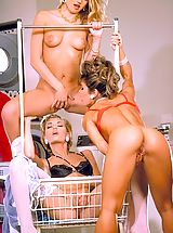 Naked Suze Randall, Bored babes Dionna, Renee, and Sara St. James hang loose in the laundromat.