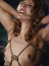 Vintage Look, Curly petite blonde girl tied tight with ropes