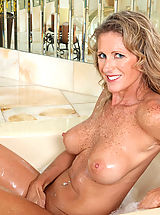 Hard Nipples, Seductive Anilos Jade gets wet in the tub and fondles her pink juice box