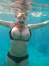 Kelly gets naked underwater and uses her 34ff's as floatation devices.
