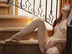 Redhead Elle Alexandra is so hot and horny that she has to stop everything and pleasure her needy pussy on the stairs