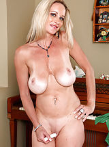 naked blonde, Milf Cassy Torri flaunts her big tits and pleasures herself with a purple vibrator