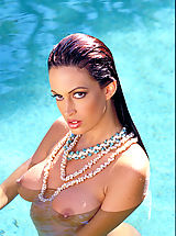 Nipples, Ms. lovely legs Nikki Nova spreads them for you around a rock star's pool.
