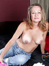 [Spintax1], Busty Anilos Kashmir peels off her tight jeans and masturbates