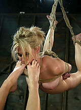 Fetish Pics: Blonde girl gets whipped and fucked by Lesbian.